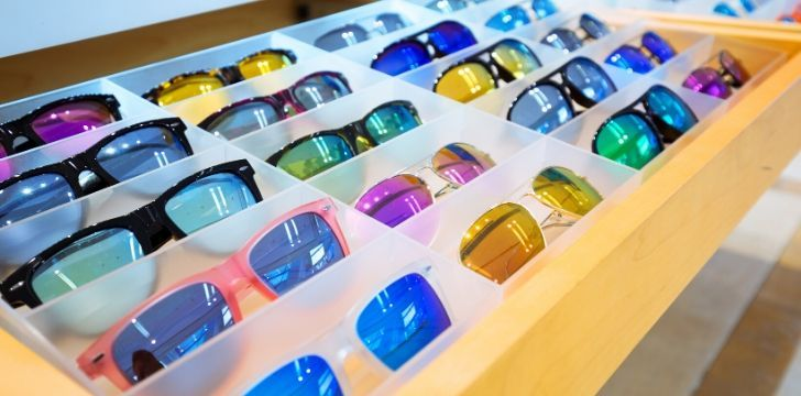 A tray of sunglasses in many colours
