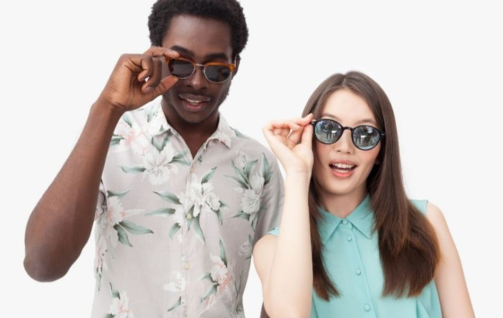 A man and woman wearing sunglasses