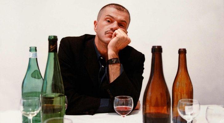 Franco Moschino drinking wine